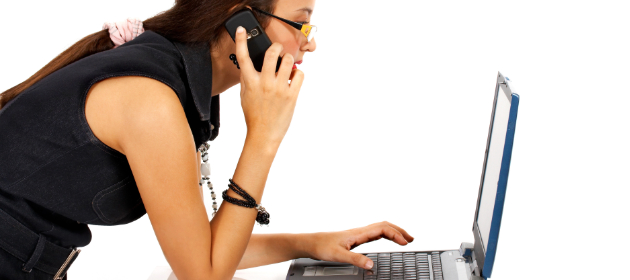 Woman on phone and keyboard