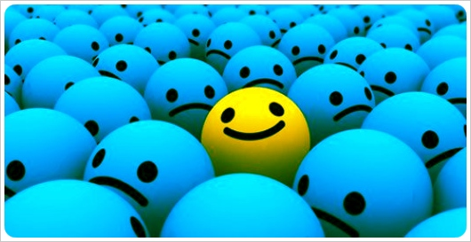 yellow happy face is a sea of blue faces