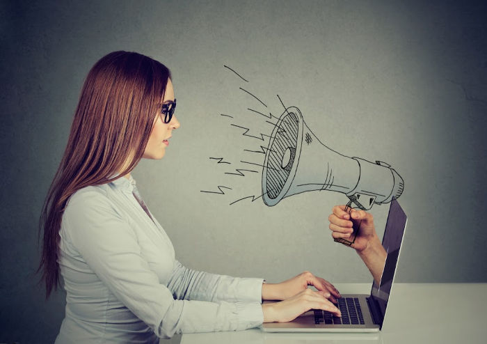woman with megaphone computer