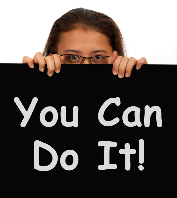 Young Woman Holding A You Can Do It Sign