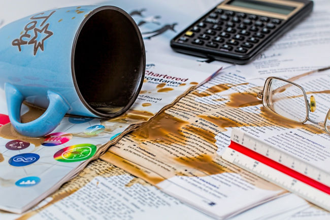 coffee spilled over paperwork