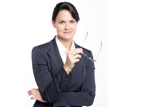 business-woman-holding-eyeglasses